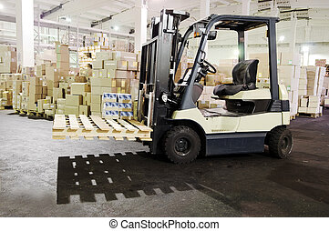 Forklift stacker in warehouse - Electric forklift stacker in...