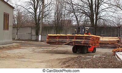 Forklift transporting wood worker video