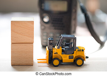 Forklift truck and wooden block with radio communication background