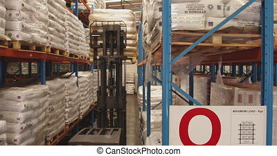 Forklift truck being used in a storage bay at a warehouse 4k...