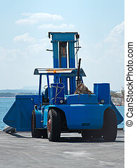 Forklift truck for boats in marine port.