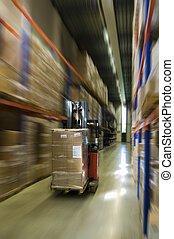 forklift truck moves through the warehouse