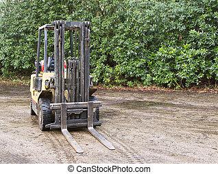 Forklift truck outside on wet concrete