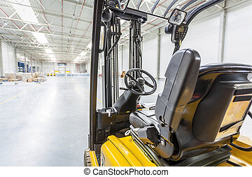 Forklift truck ready to use in modern storehouse - Forklift...