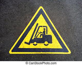 Forklift truck sign on the asphalt