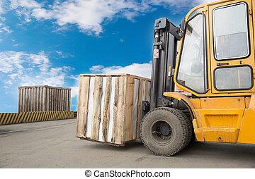 Forklift truck transporting box