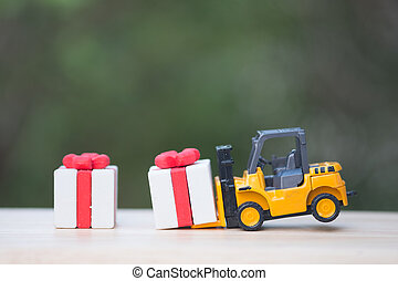 Forklift truck with christmas gift box.