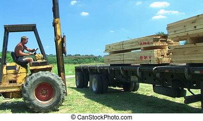 Forklift Unloading Construction Lumber 02