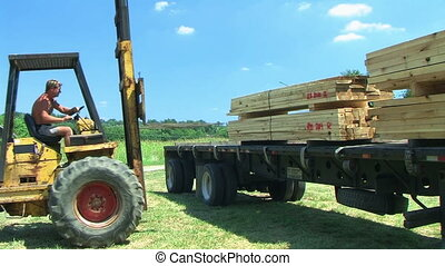Forklift Unloading Construction Lumber 02 - Forklift...
