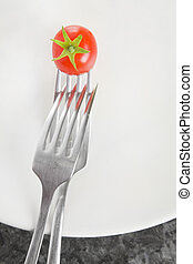 Forks and a Tomato