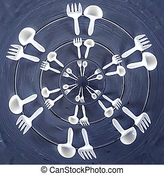 forks and spoons on the wooden table in circle pattern