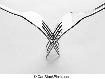 Forks - Two interlocking stainless steel forks