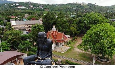 formé, structure, bourdon, noir, pond., île, samui, milieu, sculpture, koh, thailand., petit, moine, énorme, bateau, localisé, vue., étang, statue