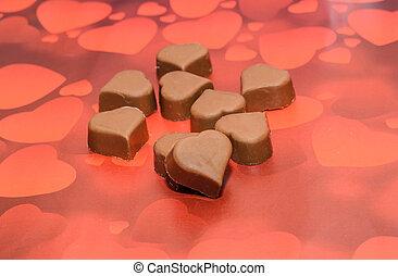 forma corazón, chocolate, día de valentines, dulces, marrón, rojo, fondo.