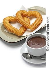forma corazón, churros, chocolate caliente