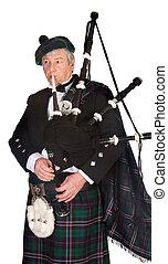Formal bagpiper - Scottish highlander wearing kilt and...
