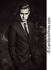 formal blue suit - Fashion shot of a handsome young man in...