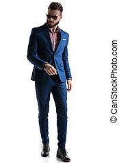 formal businessman in blue suit looking sideways alert