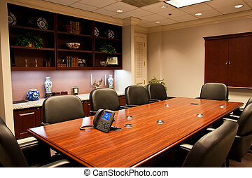 Formal Conference Room with IP Phone on Table - A formal...