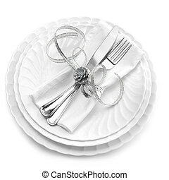 formal dinner - dishes, cutlery and napkin isolated on white...