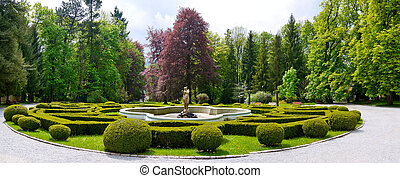 Formal garden - And ornamental fountain in a formal garden
