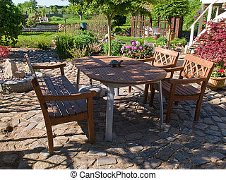Formal garden furniture in a patio - Formal classical wooden...