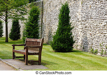 Formal garden - Wooden bench in a formal garden next to an...