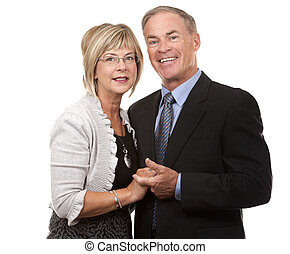 formal mature couple - formal couple posing together on...