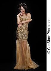 Formal Party. Glamorous Fashion Model in Elegant Golden...