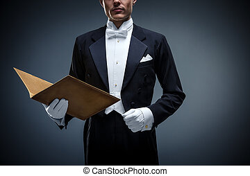 Formal - Young man in a tuxedo with folder