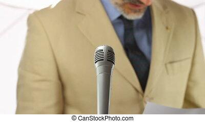 formal speaker - blurred man speaking over white