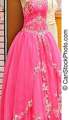 A beautiful, pink, formal gown for prom or other formal occasion
