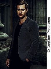 formal wear - Handsome elegant man posing on a city street....