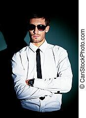 formal wear - Portrait of a handsome man over black...