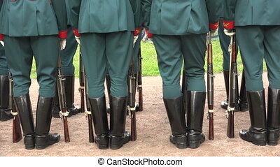 Formation of soldiers. Boots, rifle butts. 4K. - Formation...