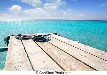 Formentera beach wood pier turquoise balearic sea