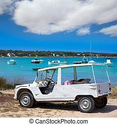 Formentera Estany des Peix with white convertible retro near...