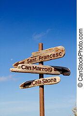 Formentera wood road signs Sant Francesc