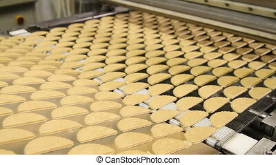 Forming dough for biscuits at the factory