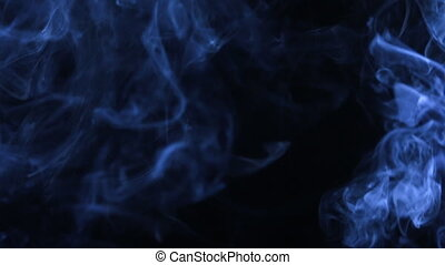 Formless jet of blue smoke for design, on black background....