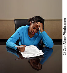 Forms - A young woman filling out forms.