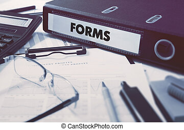 Forms on Ring Binder. Blured, Toned Image.