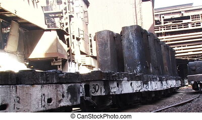 Forms on the train - Hot steel pouring in steel plant