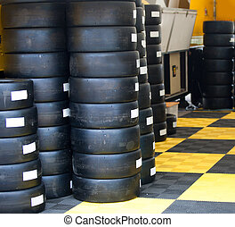 Formula One 1 race tires and wheels in boxes