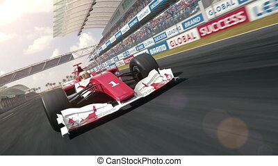 Formula one race car driving across finish line
