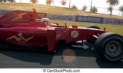 Formula one race car driving past camera