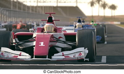 Formula one race cars waiting at start position