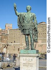 Ruins buildings and statue in the foro romano in Rome italy, emperor cesare