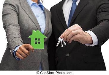 forretningsmand, og, businesswoman, holde, grønnes hus