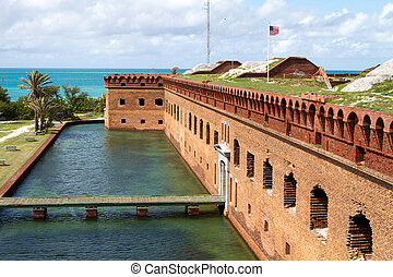 Fort Jefferson - Wooden footpath crosses the moat and leads...